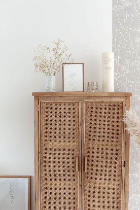 Styled Wicker Cabinet Caned Doors - May Pinterest: Top 15 Pins: A beautiful wooden rustic cabinet furniture piece with caned doors styled with white decor on top of the cabinet. @chloedominik #caneddoorcabinet #canedfurniture #canedfurnituredecor