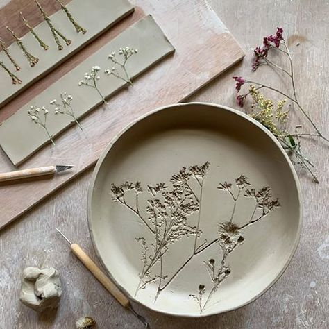 Pottery plates dried flowers imprinted into clay