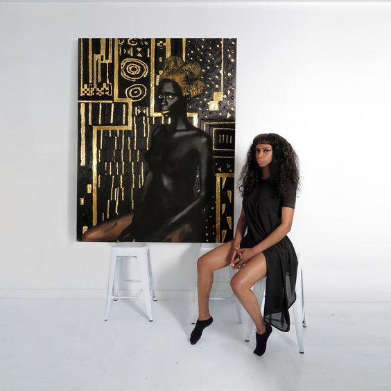 Artist Lina Iris Viktor with her work
