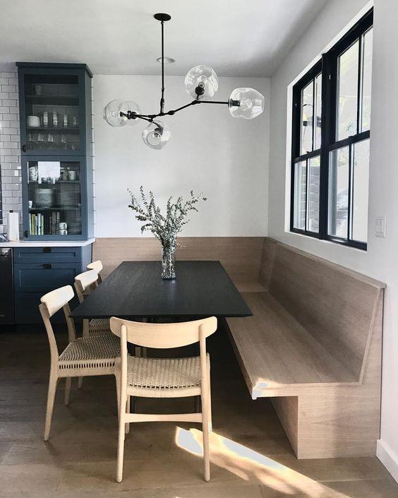 October Pinterest favs - Scandinavian kitchen banquette and globe branch light fixture
