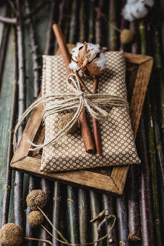 Natural Spice Scented Gift Wrap - 20 Creative Ways To Gift Wrap Your Presents This Christmas: A cinnamon stick coupled with a natural cotton twig is a perfect rustic and scented alternative for a gift wrapping idea. @chloedominik #naturalgiftwrappingideas  #rustcgiftwrappingideas #scentedgiftwrap #wrappingideas #giftwrapping #giftwrappingideas #giftwrappinginspiration #christmaspresentideas #creativegiftwrapping