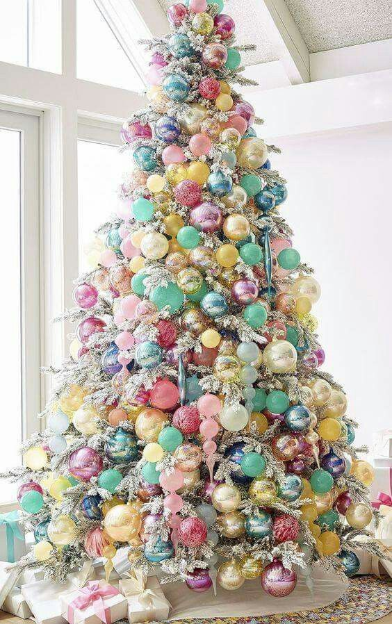 Candy Colored Tree - 20 Gorgeous Christmas Tree Decoration Ideas To Try This Year: A totally different take on the traditional Christmas tree using bright bubblegum and candy colored baubles and ornaments on this Christmas tree making it truly one of a kind. @chloedominik #christmastree #christmastreeideas #differentchristmastreeideas #brightcoloredchristmastree