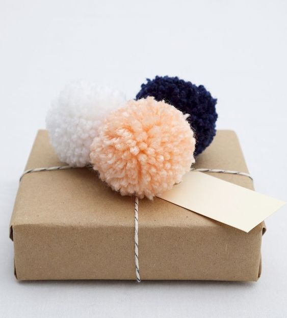 20 Creative Ways To Gift Wrap Your Presents This Christmas - PomPom Topped Present