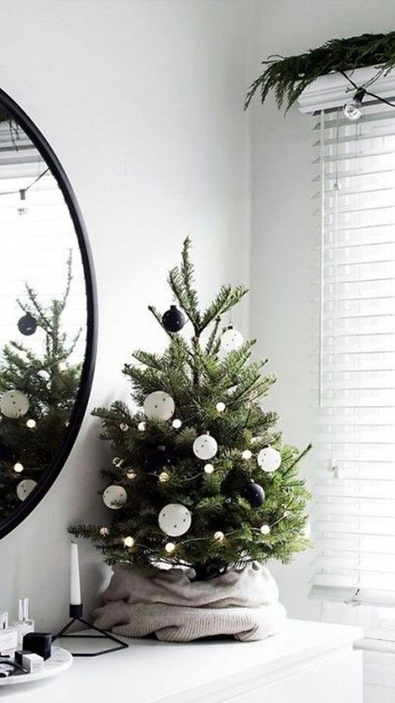 Mini Black & White Tree - 20 Gorgeous Christmas Tree Decoration Ideas To Try This Year: A cute and modern mini tree that still brings in the festive spirit in just a smaller size saving space and money. Decorated with black and white christmas baubles and twinkle light decor. @chloedominik #minichristmastree #minichristmastreeideas #modernchristmastree #blackandwhitechrsitmastree #blackandwhitechristmastreedecor
