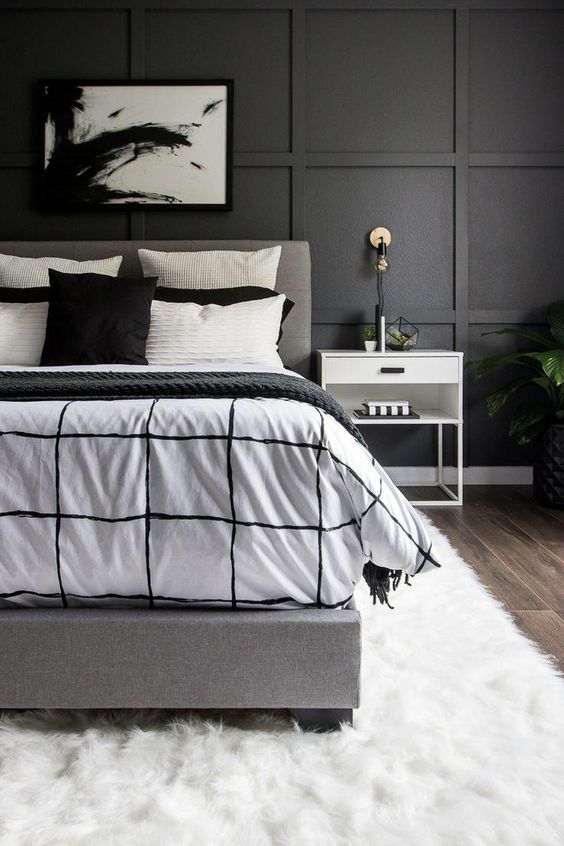 Black square panelled bedroom wall interior