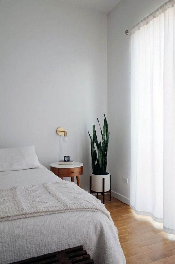 9 Tricks To Make A Small Bedroom Look & Feel Larger - Keep The Floor Clear