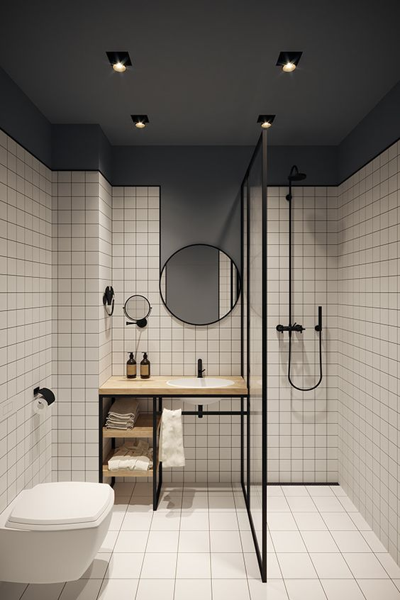 Modern White Square Tiled Wetroom - 9 Top Tips To Consider Before Creating A Great Wet Room: A modern wet room design using square tiles on the walls and floors contrasting against the dark grey upper ceiling and walls and finished with black fixtures and finishes through out. @chloedominik #wetroom #wetroomideas #wetroombathroom #modernwetroom #squaretilebathroom #whitesquaretilebathroom