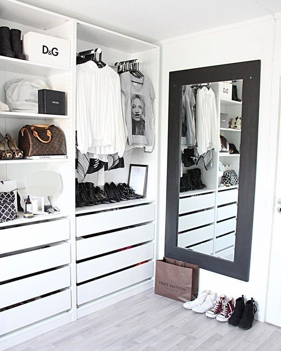 White Open Closet - 16 Amazing Stylish Wardrobe Ideas That Use The Ikea Pax: A minimal white and open Ikea Pax closet design using the full ceiling height for storage and styling in black and white for a clean and organized look. @chloedominik #ikeapax #ikeapaxideas #opencloset #whiteclosetideas #whiteclosetorganization #minimalclosetdeasign #minimalclosetideas