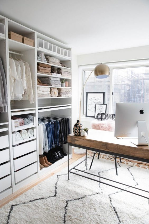 Home Office And Organized Closet Space - 16 Amazing Stylish Wardrobe Ideas That Use The Ikea Pax: Even if you have to combine two spaces into one room it can look just as great like this home office setup with a tidy and organized open Ikea Pax closet system. making the most out of one room. @chloedominik #homeofficeandcloset #homeofficeandclosetcombo #homeofficeandclosetroom #ikeapaxcloset #ikeapaxideas #opencloset #openclosetideas