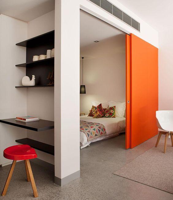 15 Interior Sliding Door Designs You'll Love - Orange Divider Bedroom