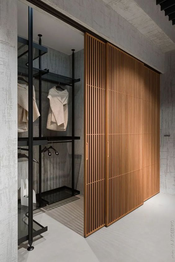 Japandi Wooden Slatted Closet Door Design - 15 Interior Sliding Door Designs You'll Love: A beautiful wooden slat sliding door design in a Japanese Scandi style. Using wooden slatted sliding doors for your wardrobe makes the area more elegant and modern space and hides away your clothes. @chloedominik #slidingdoors #slidingdoorscloset #slidingdoorclosetideas #woodenslidingdoor #woodenslidingdoorwardrobe #japandidesign