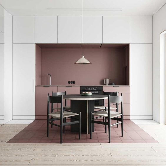 A simple and effective use of colour blocking for a kitchen interior to define the dining area and cooking area, it has triple the impact in the way the colour has been used on different planes, the back wall, cabinetry and the floor. A great colour block idea for interior design. #colourblockkitchen #colourblockinterior #colourblockinteriordesign #colourblockideas @chloedominik