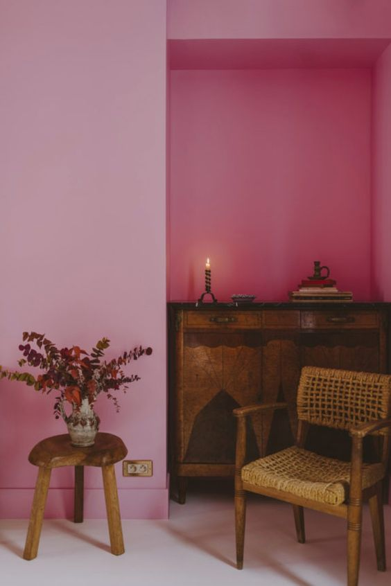 Creative interior space contrasting bright pink walls with beautiful antiqued furniture to create interest and a unique design. #contrastinginteriordesign #pinkinteriordesign #contrastinginterior @chloedominik