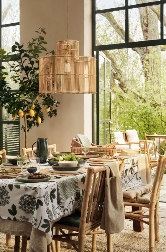 A fresh and bright table setting for indoor and outdoor use from H&M using rattan pendant light and cane furniture offset with colours green and white. #tablesettingideas #hmhome #hmhomedecorinspiration #hmhomedecor #rattanandcanedecor @chloedominik