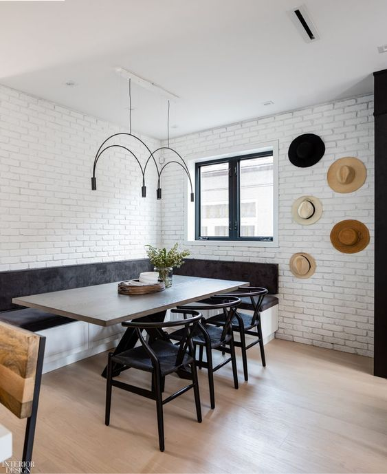 A modern and minimal breakfast nook using natural materials and monochrome colours black and white to create a sophisticated look with minimal decor to add interest to the kitchen interior. #modernbreakfastnook #minimalbreakfastnook #monochromeinterior #breakfastnookideascorner @chloedominik