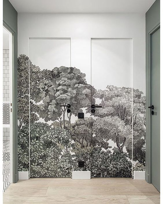 Decorating with wallpaper can make a huge impact to even the smallest spaces especially when there isn't a designated use for the space like a hallway entry. This wallpaper design covering the doors as well is a great way to make use of the space you have without it being boring! #wallpaperhallway #wallpaperhallwayentryway #hallwayideas #hallwaydecorating #hallwaydecoratingwallpaper #hallwayinterior #hallwayinspiration @chloedominik