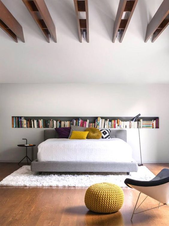 A cool simple white bedroom design with a feature long horizontal wall niche just above the headboard to add your personality to a minimal space. A perfect headboard wall design for book lovers, a mini library within an arms reach of your bed or just a display area for your little décor items to fit snuggly in the recessed wall niche. #bedroomfeaturewall #bedroomheadboardwall #minilibraryinbedroom #wallniche #wallnichebedroom #recessedwallnichedecor @chloedominik