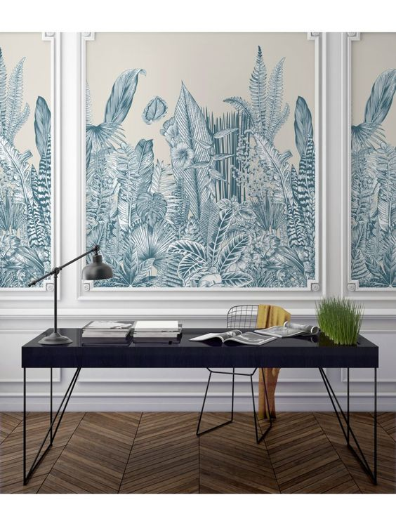 A wall panelled home office featuring decorative wallpaper centre of the panelling with a simple black desk placed in the front. A decorative and inspirational place for working. #decorativehomeoffice #wallpanellingideas #homeoffice #homeofficeideas #wallpaneldesign @chloedominik