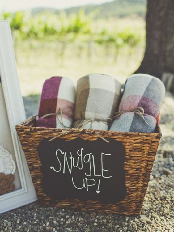 Blankets For Guests - 9 Essentials For Hosting The Perfect Garden Party: Providing rolled up blankets in a storage basket for your guests to cozy up under once your garden party goes past dusk is going to make you the best host ever! @chloedominik #gardenparty #gardenpartyideas #gardenpartydecor #hostingagardenparty #gardenpartyessentials #gardenpartyblankets