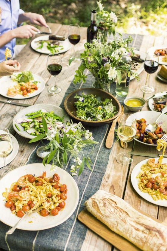Outdoor Dinner Table - 9 Essentials For Hosting The Perfect Garden Party: A simple, beautiful outdoor dinner table set up and so quick to do with just a simple fabric table runner down the centre, decorated with vases full of handpicked flowers. A rustic look for your garden party. @chloedomink #outdoordinnerparty #gardenparty #outdoordinnerpartiestablescapes #gardenpartytabledecor #rusticgardenpartytabledecor #gardenpartytablesetting #gardenpartyessentials #hostingagardenparty