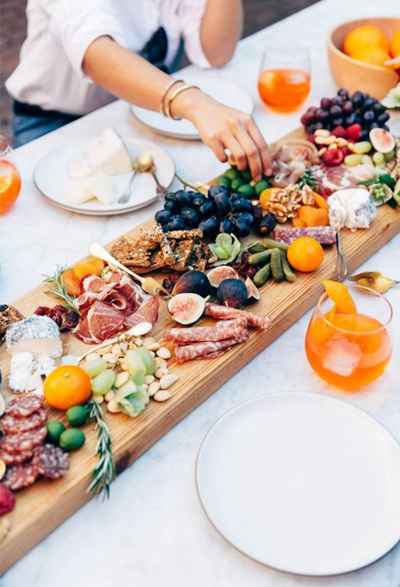 Grazing Board - 9 Essentials For Hosting The Perfect Garden Party: A grazing board is a great idea for food for your guests. Easy to prepare, doubles as a table decor piece to when your guest first arrive as well as being edible @chloedominik #outdoortabledecor #gardenparty #gardenpartyideas #gardenpartydecor #hostingagardenparty #gardenpartyessentials #grazingboard #gardenpartyfood