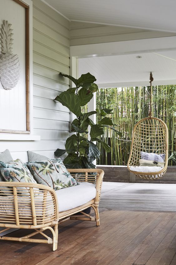 A hanging rattan chair and rattan seat is a perfect outdoor set for relaxing outside your home and in your garden. #rattangardenfurniture #hangingrattanchair #hangingrattanchairoutdoor #rattanoutdoorfurniture @chloedominik