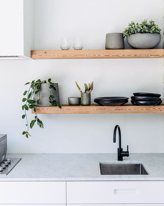Styled Wooden Kitchen Shelves - 7 Simple Daily Tasks To Keep Your Home Organized: Clean and clear kitchen counter top surfaces along with storage shelves help the kitchen free of clutter. @chloedominik #cleankitchen #cleankitchencountertops #kitchenorganization #homeorganization #kitchenopenshelves #woodenshelveskitchen