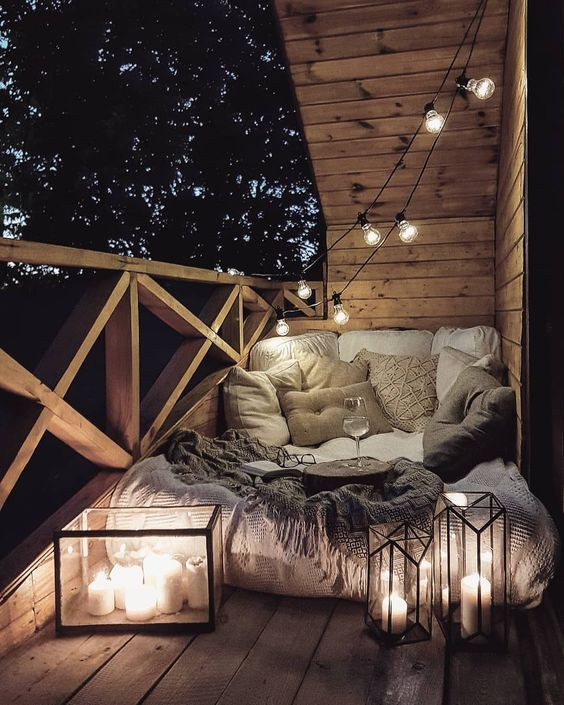 Cozy Outdoor Balcony - Using Garden Lanterns: 10 Favourites: A beautiful cozy outdoor set up, perfect for a Summer's night. Making the most of the small balcony space just by using floor cushion, blankets, garden lanterns and a tonne more of throw cushions!  @chloedominik  #smallbalconyideas #cozybalconyideas #lanterns #cozybalconysmall #lanternsdecor #gardenlanterns #cozybalconydecor
