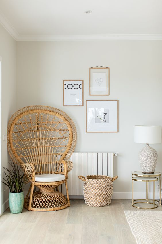 A beautiful natural rattan peacock chair styled in a living room corner with decor and accessories makes an interesting and decorative feature in the room as well as an extra seat. #peacockchair #peacockchairlivingroom @chloedominik