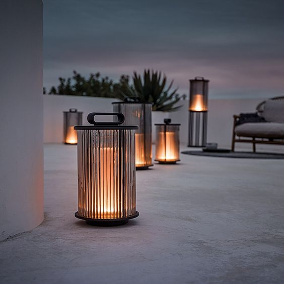Lantern Decor Roof Patio - Using Garden Lanterns: 10 Favourites: These beautiful glass lanterns add a lighting ambience and brighten up the concrete rooftop terrace patio. @chloedominik #lanterns #lanternsdecor #roofpatio #gardenlanterns #roofpatiorooftopterrace #gardenpartydecorations #gardenlanternoutdoor #gardenlanternideas #gardenlightingideas
