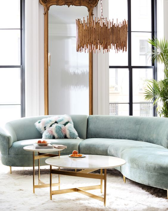 The Curved Sofa: 4 Reasons Why The Interior Trend Is Taking Over: Anthropologie has some great curved sofas for your living room a perfect statement piece and to create an interesting and intimate living room setting for friends and family. @chloedominik #curvedsofa #curvedsofalivingroom #anthropologielivingroom #anthropologiecurvedsofa #livingroominterior