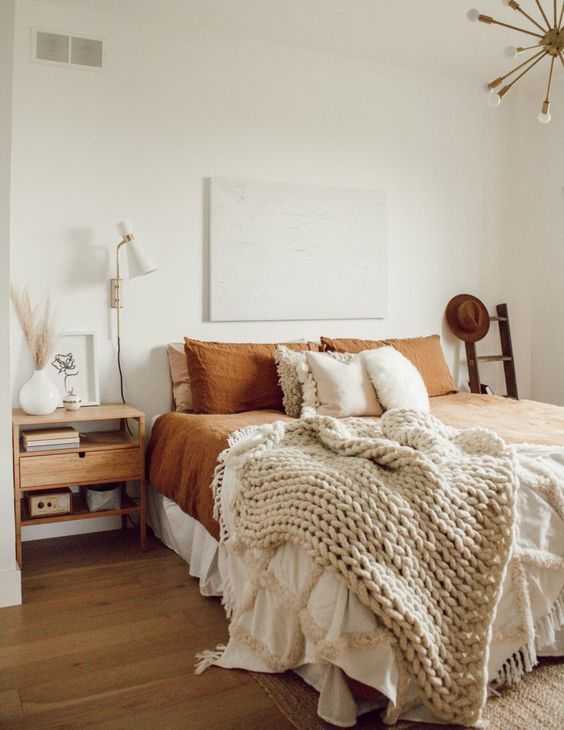 Modern Boho Bedroom - 10 Interior Design Mistakes And How To Fix Them: A lovely modern boho styled bedroom that has forgone the matching nightstands either side of the bed replacing one side with a decor ladder. Nothing in the bedroom matches but it still looks great. @chloedominik #modernbohobedroom #modernbohobedroomideas #interiordesigntips #interiordesignmistakes #relaxedbedroomdecor #relaxedbedroomideas