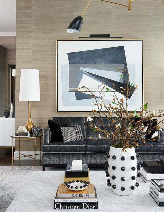 Modern Artwork Living Room Interior - Design Mistakes And How To Fix Them: Hanging the artwork  is an important interior design tip to get right like hanging this abstract painting above the sofa in this modern living room. @chloedominik #livingroom #modernlivingroom #artworkabovesofa #interiordesignmistakes #interiordesigntips #hangingartwork #livingroomdecor