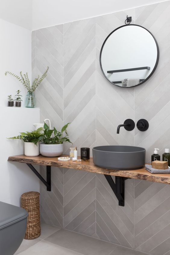 Marble Chevron Bathroom Wall - 6 Great Marble Alternatives For Around Your Home: A beautiful modern bathroom wall using a white grey chevron marble tile pattern on the wall with a floating wood countertop to contrast colour and texture. @chloedominik #chevronbathroomwall #marblealternative #marblealternativewall #marblealternativecountertops #interiortrends #chevronbathroomtilewall #floatingcountertopbathroom