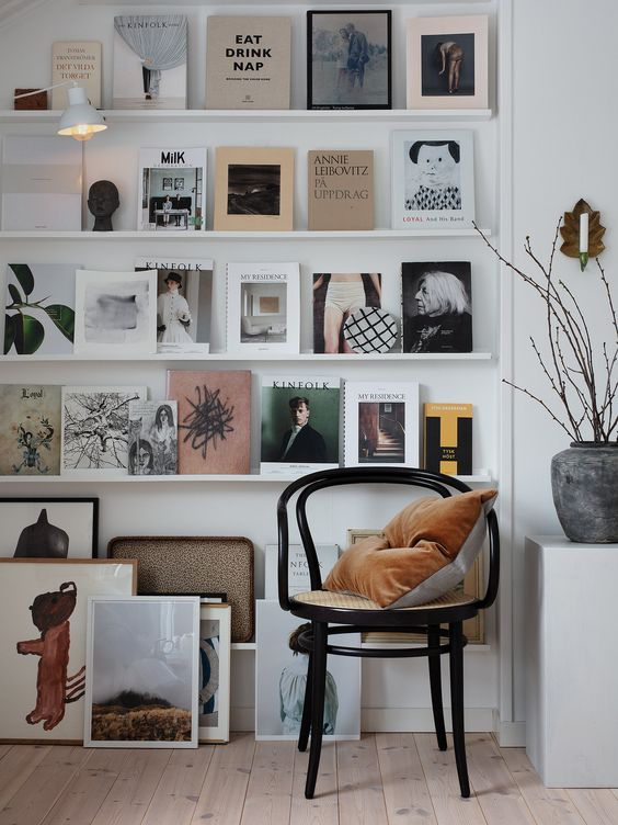 Book Ledge Wall - July Pinterest 2020: Top 15 Inspiration & Ideas: A book ledge wall is the perfect way to display your favourites and for a constant reminder for inspiration in your home and a creative way to fill an empty wall as a feature wall idea for books or picture frames. A cute little reading spot. Design by Janniche Kristofferson. @chloedominik #bookledgewall #bookledgegallerywall #featurewallideas #readingcorner #readingspot #readingspotideas