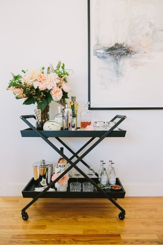 Modern Styled Bar Cart Decor - 7 Ways To Decorate An Empty Corner At Home: A cool and modern black bar cart styled with glassware, drinks and decor is something fun and different to include in your empty corner. Sure to be a talking piece and draw your guests in when they come and visit. @chloedominik #barcartideas #emptycorner #emptycornerideas #styledbarcart #barcartdecor #barcartdecorideas