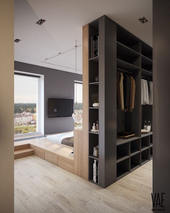Modern Walk In Closet - 9 Amazing Bedroom Divider Closet Ideas To Maximize Your Space: A beautiful modern bedroom design with everything you need in one open space with a clever layout with the walk in closet at the back on the sunk in bed. @chloedominik #bedroomdivider #bedroomdivisionideas  #bedroomdividerideas #bedroomclosetdividerideas  #roomdividerideas #walkinclosetdesign #modernbedroomdesign