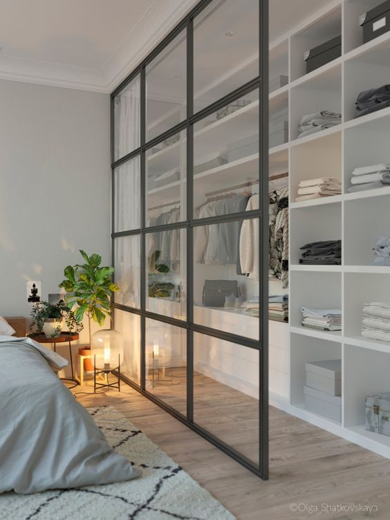 Glass Screen Closet Wall - 9 Amazing Bedroom Divider Closet Ideas To Maximize Your Space: A glass wall helps as a dividing wall helps the bedroom to feel a little more open even though there is a wall divider between the bedroom and the closet space. Just draw the curtain to hide the closet area while sleeping. Design by Olga Shatkovskaya. @chloedominik #bedroomdivider #bedroomdivisionideas  #bedroomdividerideas #bedroomclosetdividerideas #bedroomclosetdivider #glassdividerwallbedrooms