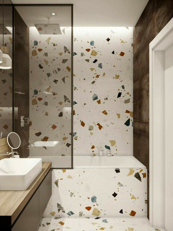 Modern Terrazzo Bathroom - 6 Great Marble Alternatives For Around Your Home: A small bathroom has a modern design using terrazzo as a neutral base for all over the bathroom for a totally different look. @chloedominik #terrazzobathroom #terrazzobathroomdesign #marblealternative #marblealternativewall #marblealternativecountertops #interiortrends