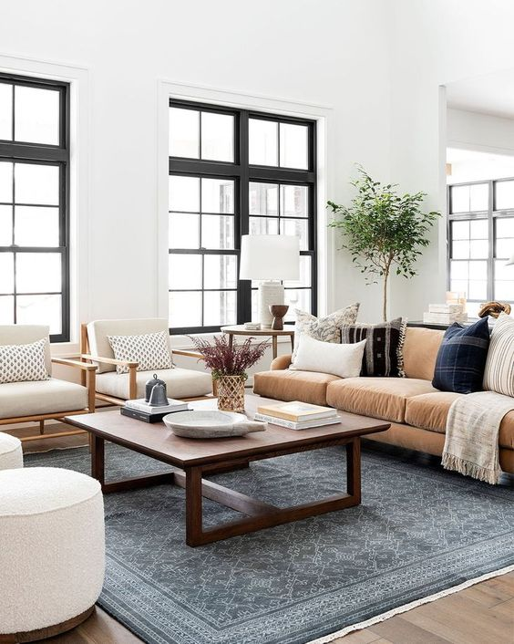Blue Area Rug Living Room Studio McGee - 10 Interior Design Mistakes And How To Fix Them: This gorgeous blue rug from Studio McGee & Co contrasts the space beautifully in this modern living room space. The perfect area rug size that fits all the furniture on to ground the seating area in the living room. @chloedominik #livingroom #bluearearugs #bluearearugsinlivingroom #studiomcgeelivingroom #interiordesigntips #interiordesignmistakes
