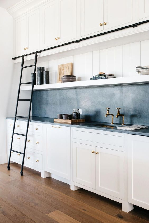 White And Soapstone Kitchen - 6 Great Marble Alternatives For Around Your Home: A beautiful white transitional kitchen design featuring a blue grey soapstone for the backsplash and countertops which make an impact against the white cabinetry of the kitchen. @chloedominik #whitekitchensoapstonecountertops #whitekitchencabinets #soapstonecountertops #marblealternative #marblealternativewall #marblealternativecountertops #interiortrends