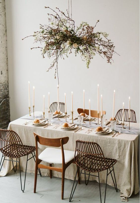 Gorgeous Rustic Table Scape - July Pinterest 2020: Top 15 Inspiration & Ideas: A stunning but simple rustic neutral  table scape for a small wedding or a dinner evening using a gathered floral arrangement to hang above and a linen cloth with white candlesticks to decorate the table. @chloedominik #rustictablesetting #rustictablescape #tablescape #tablescapeideas #simplerustictablescape