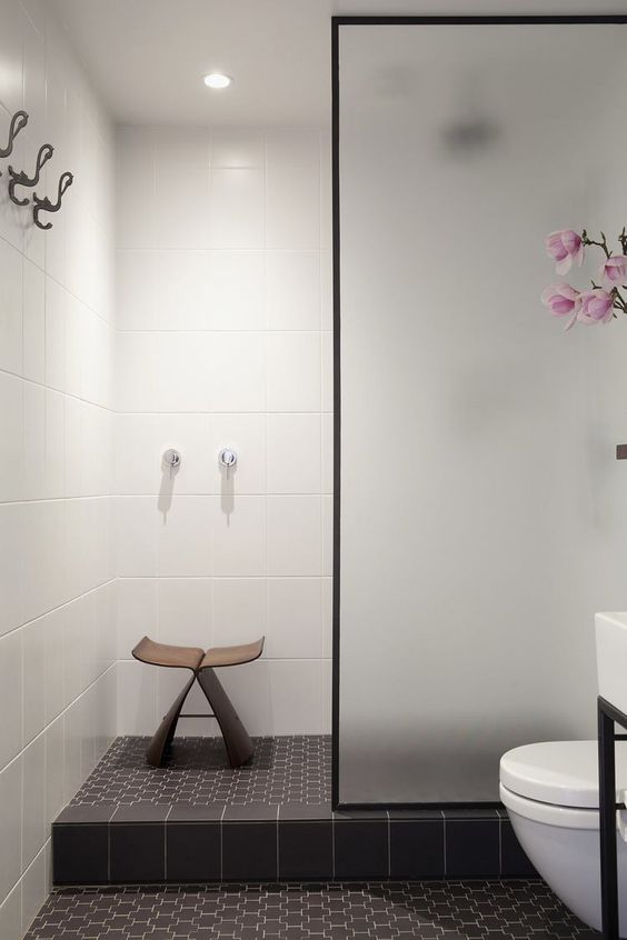 Small Elegant Black and White Shower Room July Pinterest 2020: Top 15 Inspiration & Ideas: A simple and small elegant black and white shower room walk in using white tiles for the walls and black patterned tiles for the floor. A frosted glass panel provides the shower screening from the rest of the bathroom. @chloedominik #blackandwhiteshowerroom #showerroom #showerroomideas #showerroomideaswalkin #showerroomideaswalkinsmallspaces