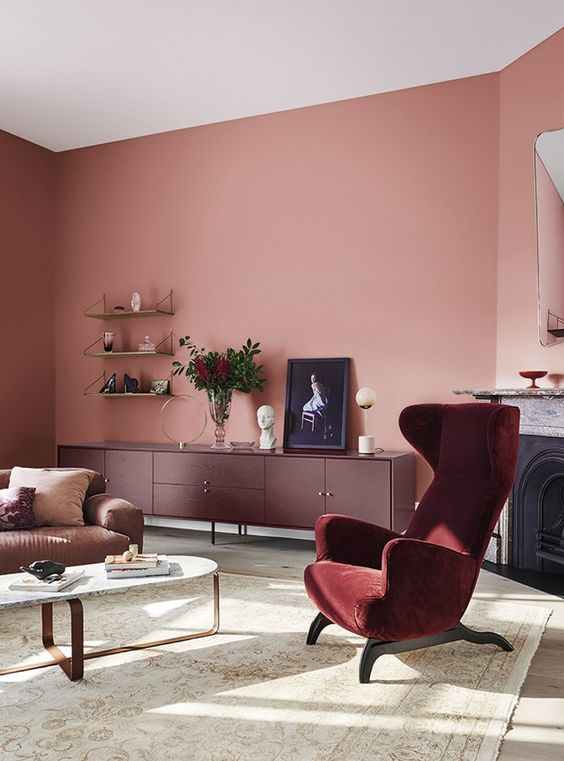 Raspberry Colour Living Room - 10 Interior Design Mistakes And How To Fix Them: This gorgeous raspberry colour toned living room has different shades of red and pink throughout the interior design scheme in the furniture and seating, proof that you should actually pick your paint colour last! @chloedominik #raspberrylivingroom #pinklivingroomideas #colourinlivingroom #redfurniturelivingroom #interiordesigntips #interiordesignmistakes