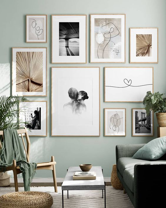 Desenio Muted Gallery Wall - 7 Ways To Get Affordable Artwork For Your Home: A minimal gallery wall by online art print company Desenio created a beautiful Scandi style gallery wall with a muted green backdrop and simple prints featured. @chloedominik #desenioprints #gallerywall #affordableartwork #walldecor #walldecorlivingroom #gallerywalllivingroom #scandigallerywall