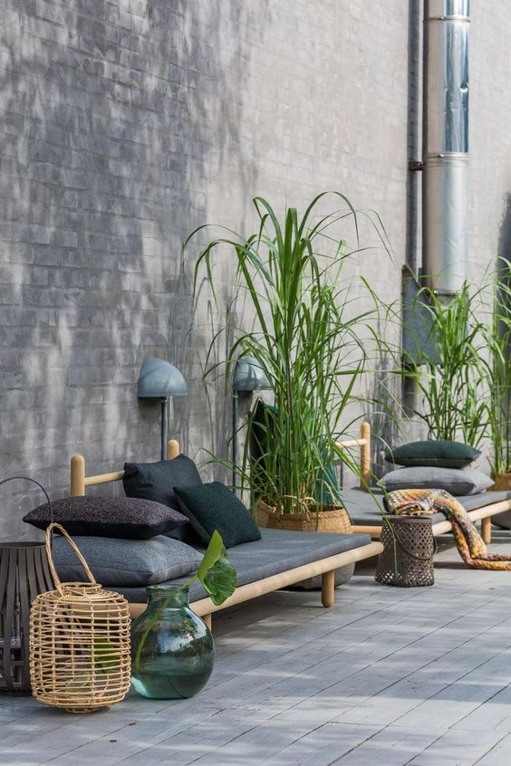 Garden Seating Area: July Pinterest 2020: Top 15 Inspiration & Ideas: A few glass vases, rattan lanterns and potted plants placed to to some lying seating makes a lovely garden patio area for the summer. @chloedominik #gardenpatioideas #gardendesign #gardendecor #gardenseatingarea #gardenseatingideas #gardenseatingarea