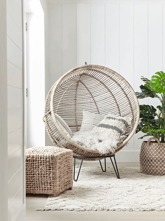Statement Cocoon Chair - 7 Ways To Decorate An Empty Corner At Home: Finishing off the room with a statement chair in the corner of a living room is an ideal spot to put it allowing for private time and social time in the main seating area of the living room @chloedominik #emptycorner #emptycornerideas #cocoonchair #cocoonchairlivingroom #statementchairlivingroom