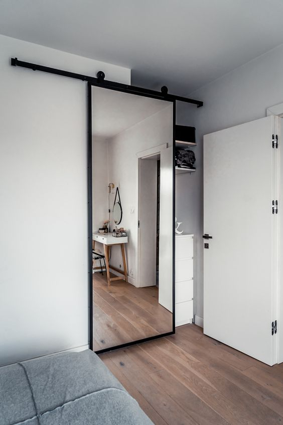 Mirrored Closet Barn Door - 9 Amazing Bedroom Divider Closet Ideas To Maximize Your Space: Using a sliding doors in to your bedroom is a great way to maximize your space if you have a small bedroom or closet area. A sliding mirrored barn door well help make the space seem larger. @chloedominik #bedroomdivider #bedroomdivisionideas  #bedroomdividerideas #bedroomclosetdividerideas #slidingdoorcloset #mirroreddoorscloset