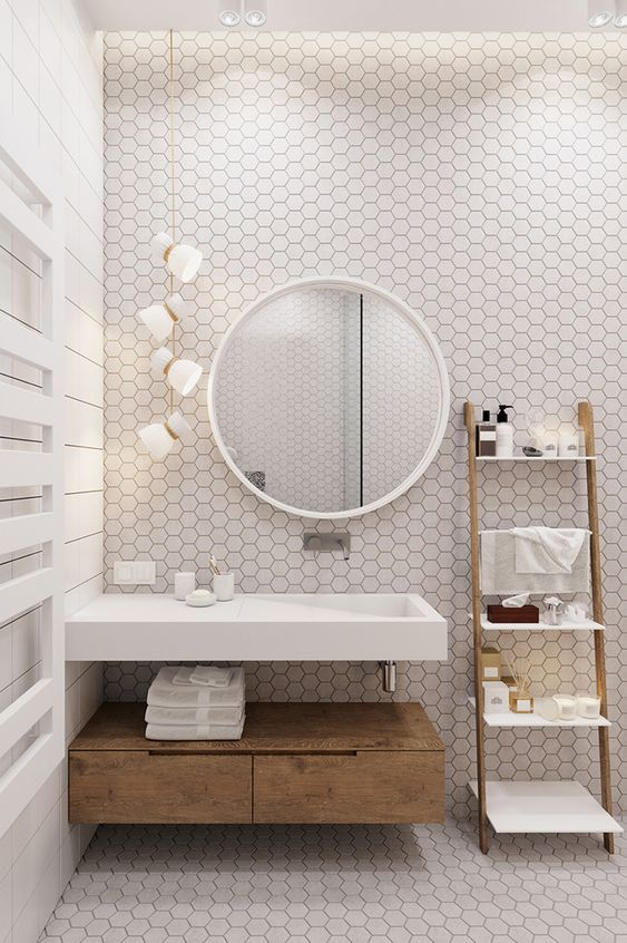 White Hexagon Tiled Bathroom - 6 Great Marble Alternatives For Around Your Home: A modern bathroom design using white hexagon tiles for the bathroom back wall and the floor. The floating vanity sink helps show off the hexagon design even more. @chloedominik #hexagontilebathroom #whitehexagontilebathroom #marblealternative #marblealternativewall #marblealternativecountertops #interiortrends