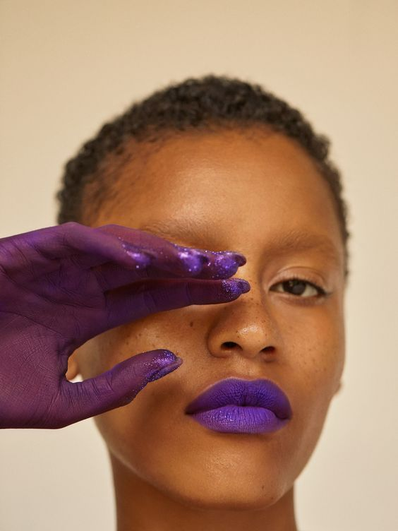 High Fashion Photo Black Model - 7 Ways To Get Affordable Artwork For Your Home: Beautiful photograph from Wonderland magazine featuring a close up of a black model in headshot view with her hand covered in vibrant purple paint covering one eye and matching lip colour. Sometimes yo find things in magazines that are too good to hide beneath the pages, it needs to be displayed on the wall! @chloedominik #walldecor #affordableart #gallerywall #blackmodels #highfashionphotographyblackmodel
